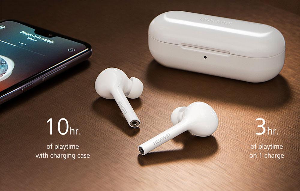 Наушники Huawei FreeBuds на столе